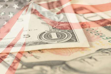Flag of USA and dollar bills Stock Photo