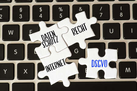 A computer, privacy code and puzzle pieces with the words Privacy, Law and Internet Stock fotó