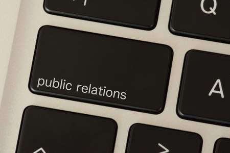 A computer and a public relations button