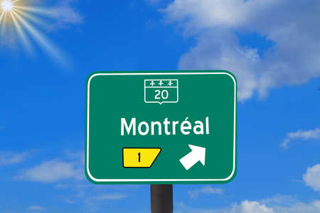 A road sign in Canada indicates the direction to Montreal