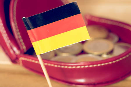 Flag of Germany, wallet and Euro coins