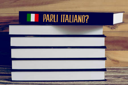 Various books and a book for Italian language Foto de archivo
