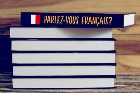 Various books and a book for French language Banco de Imagens