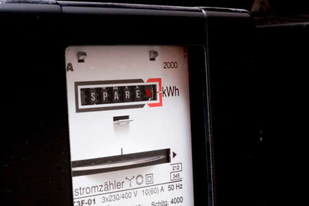 An electricity meter and the word SAVE
