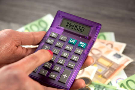 Euro banknotes and a calculator for debt collection costs