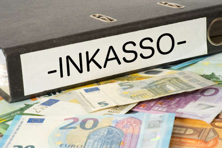 Euro banknotes and a file folder with the imprint Inkasso Stock fotó