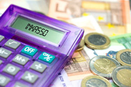 Euro bills and coins, calculator and debt collection Standard-Bild - 109499748