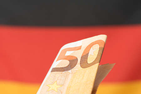 Flag of Germany and a Euro bill Stock Photo