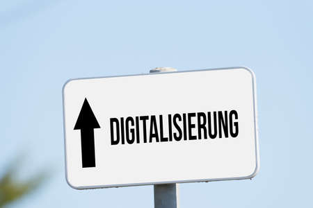 A sign points to digitization