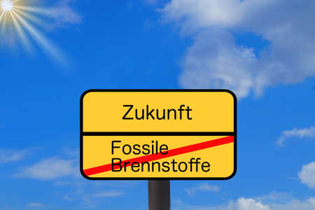 A sign indicates the end of fossil fuels and the beginning of the future