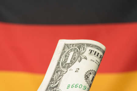 Flag of Germany and dollar banknote 스톡 콘텐츠