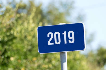 A sign indicates the year 2019