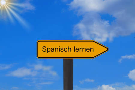 A sign with the words Learn Spanish Stock Photo