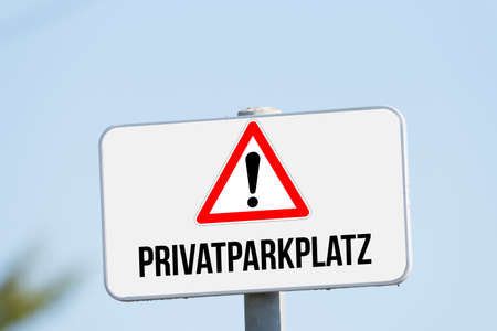 A sign indicates private parking
