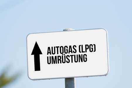 A sign indicates conversion for LPG gas for cars Stock Photo