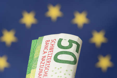 Flag of the European Union EU and banknotes Swiss Franc Stock Photo