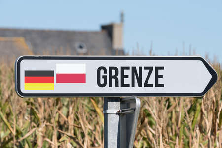 A sign points to the border between Germany and Poland Stock Photo