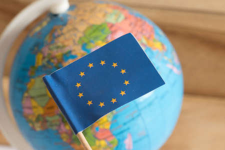 Flag of the European Union EU and a globe in the background Stock Photo