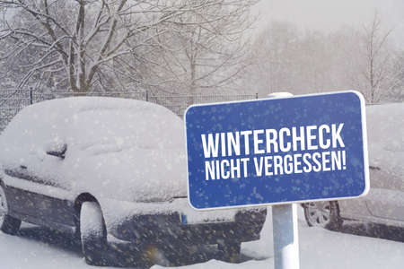 Winter, a car and a sign with the imprint Wintercheck Do not forget Stock Photo