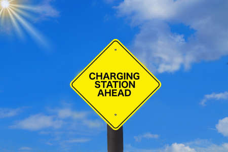 A sign indicates a charging station for electric cars 스톡 콘텐츠