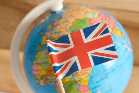 Flag of Great Britain and a globe in the background