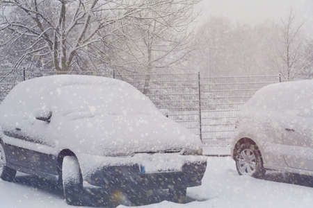 Winter, snow and snowy cars in a parking lot