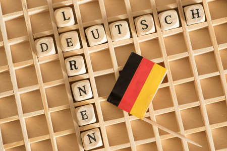 Flag of Germany, wooden letters and words learning german Standard-Bild