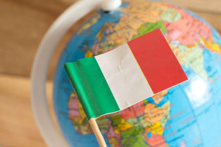 Flag of Italy and globe in the background
