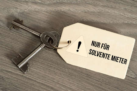A key and key fob with the reference to rental only for solvent tenants Stock Photo