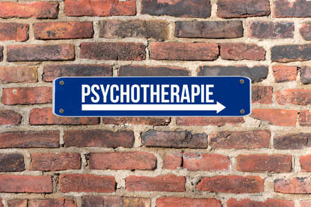 A sign on a wall indicates psychotherapy
