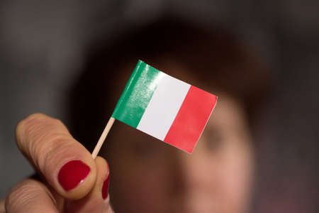 A woman and flag of Italy