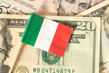 Flag of Italy and dollar bills in the background
