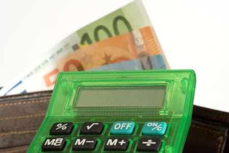 Wallet, calculator and euro bills