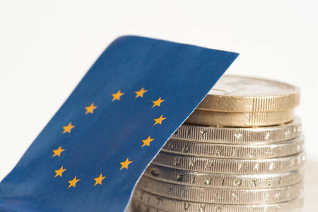 Flag of the European Union EU and Euro coins