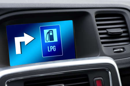 Navigation in the car shows the direction to an LPG LPG gas station
