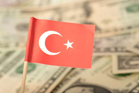 Flag of Turkey and dollar bills in the background 스톡 콘텐츠