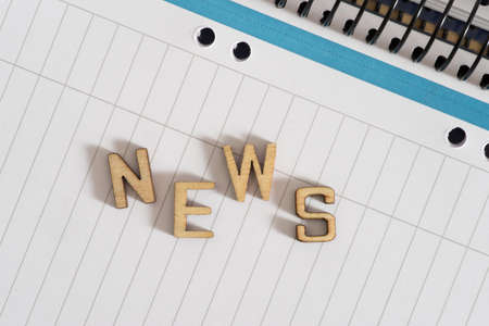 A notepad and the news