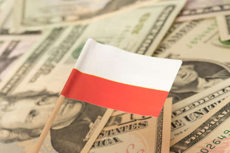 Flag of Poland and dollar bills in the background