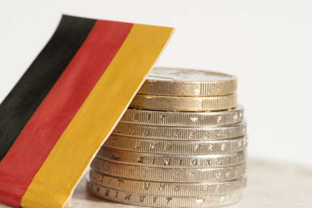 Flag of Germany and Euro coins Standard-Bild