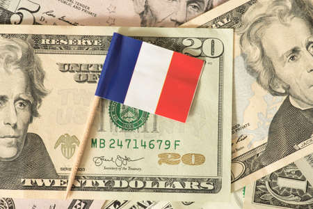 Flag of France and dollar bills in the background Stock Photo