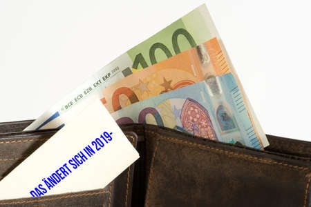 A wallet, euro bills and note changes in year 2019
