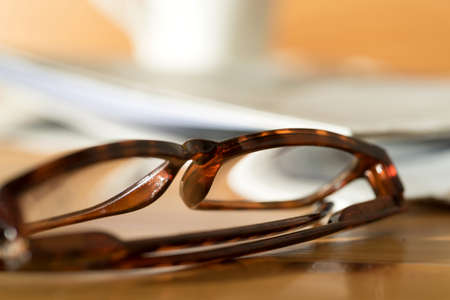 A reading glasses and a newspaper 写真素材