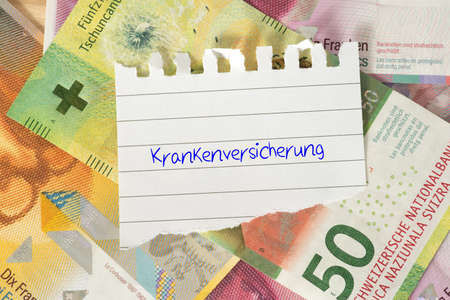Banknotes Swiss francs and the cost of health insurance in Switzerland Stockfoto - 118610355