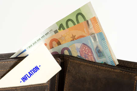 A wallet with Euro bills and inflation in Europe