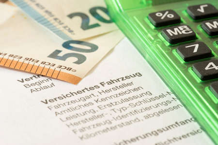 Euro banknotes, calculator and insurance certificate for a car insurance