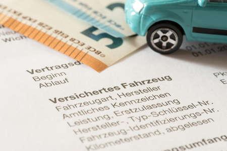 A car, euro bills and the car insurance