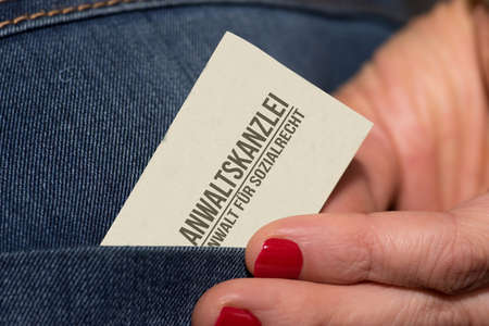A woman and a business card from a social lawyer