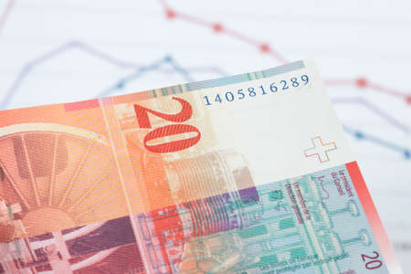 A chart and a Swiss franc banknote