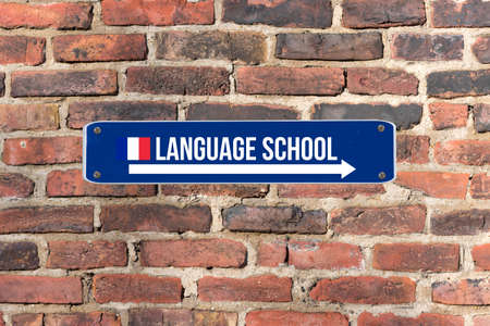A sign on the wall indicates the language school for French language