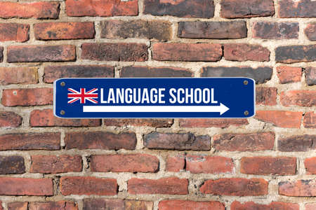 A sign on the wall indicates the language school for English language